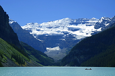 A Mountain Range With A Lake In The Foreground