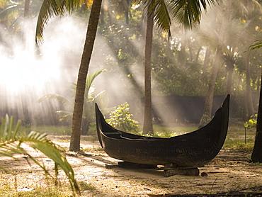 Sunlight Shining On A Canoe