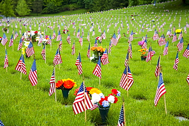 Memorial Flowers And Flags In A Graveyard In Oregon, Usa