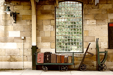 Suitcases On A Luggage Trolley In A Train Station