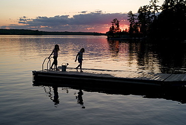 Lake Of The Woods, Ontario, Canada, Two Girls On A Dock