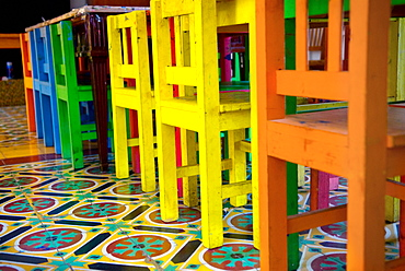 Mexico, Colorful Chairs On A Tiled Floor