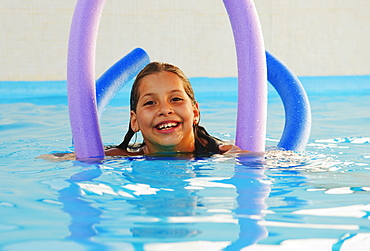 Girl In Pool With Pool Noodles