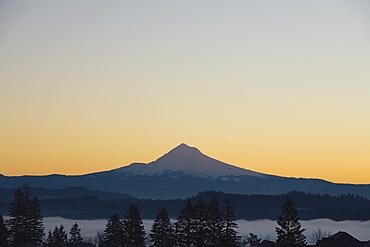 Silhouette Of Mountain Peak At Sunrise