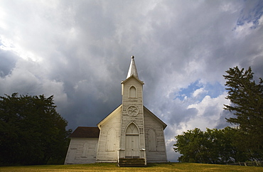 Weathered Church And Dark Skies