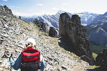Woman Hiking On A Mountain Trail