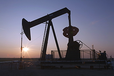 Pumpjack And Sunrise, Central Alberta, Canada