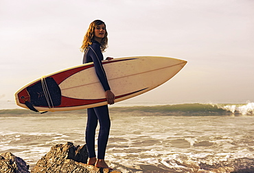 Young Woman With Her Surfboard At The Beach, Tarifa, Cadiz, Andalusia, Spain