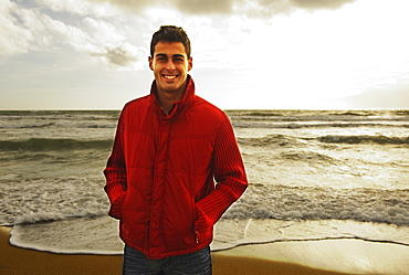 A Young Man Standing On A Beach, Tarifa, Cadiz, Andalusia, Spain