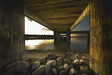 Alberta, Canada, Underneath A Pier Going Out Into The Lake