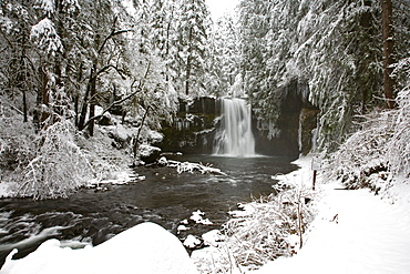 A Waterfall In To A River In Winter
