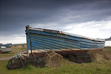 Lindisfarne, Northumberland, England, A Boat And Fishing Traps On The Shore