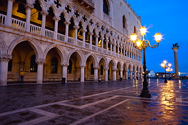 A Street Light Illuminated At Night In Front Of A Building, Venice, Venezia, Italy