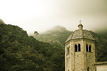 Low Lying Cloud In The Hills And A Cross Atop A Building's Tower, San Frutuozzo, Liguria, Italy