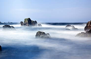 Mist Surrounding Big Rocks In The Water, Northumberland, England