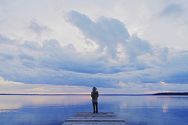 Woman On Public Dock Clear Lake, Canada, Manitoba, Riding Mountain National Park