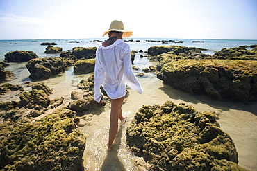 A Woman Tourist Enjoys The Sunshine On The Beach Of A Tropical Island, Koh Lanta, Thailand