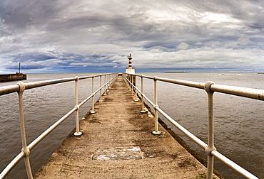 Lighthouse At The End Of A Pier, Amble, Northumberland, England