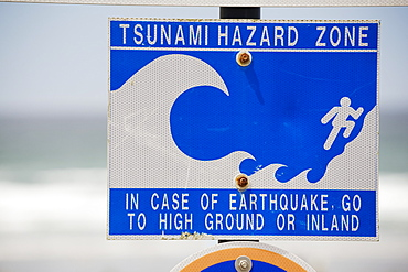 Tsunami Warning Sign With The Ocean In The Background, Lincoln City, Oregon, United States of America