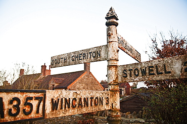 Old style road sign on A357 on the edge of South Cheriton village, Somerset England