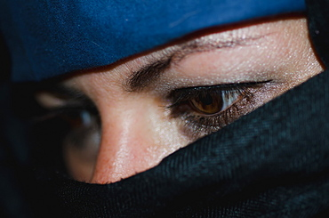 A woman wearing a hijab with only her eyes showing, Locarno ticino switzerland