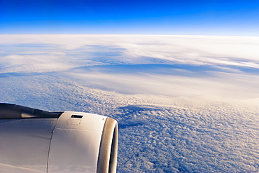 Plane flying over clouds