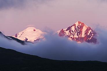 Mountain Peaks Above The Clouds On Hallo Bay, Katmai Naional Park, Alaska Peninsula, Southwest Alaska, United States Of America