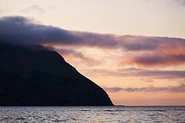 Clouds Colored By The Setting Sun Near King Cove, Alaska Peninsula, Southwest Alaska, United States Of America