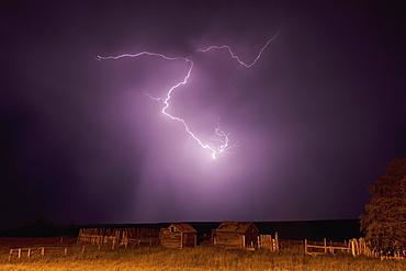 Lightning bolt over some abandoned buildings near val marie, Saskatchewan canada