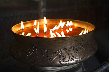 Flames burning in a bronze container at the jokhang temple, Lhasa xizang china