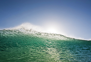 Sunlight reflecting on the water as it swells and splashes, Tarifa cadiz andalusia spain