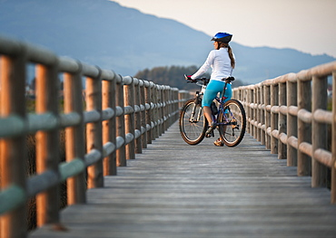 A Cyclist On A Wooden Boardwalk, Tarifa, Cadiz, Andalusia, Spain
