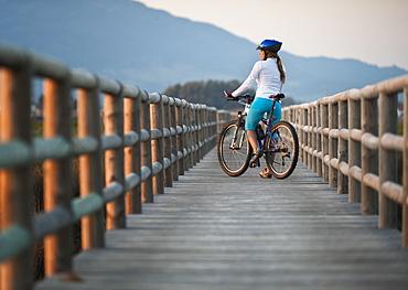 A Cyclist On A Wooden Boardwalk, Tarifa, Cadiz, Andalusia, Spain