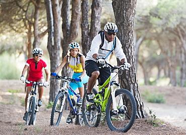 Three adult cyclists on a path, Tarifa cadiz andalusia spain