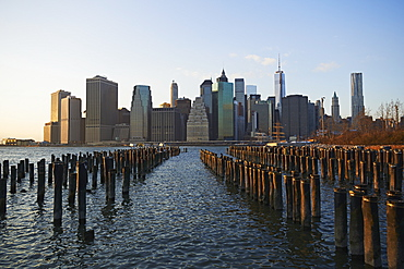 View Of Financial District Of Manhattan From Brooklyn Bridge Park At Sunset, New York City, New York, United States Of America