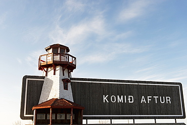 A Wooden Sign With Lighthouse Saying Komid Aftur In Hecla-Grindstone Provincial Park, Manitoba, Canada