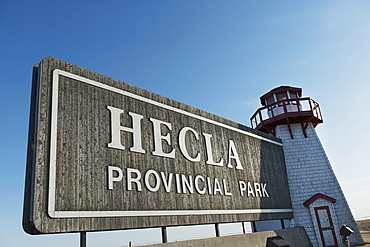 A Sign And Lighthouse For Hecla Provincial Park, Manitoba, Canada