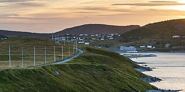 A Road Along The Atlantic Coast Leading To A Coastal Village At Sunset, Calvert, Newfoundland And Labrador, Canada