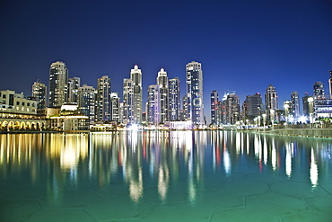 Skyline Of Dubai And The Buildings Reflected In Tranquil Water, Dubai, United Arab Emirates