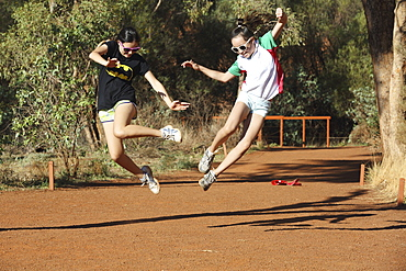 Two Girls Leaping In The Air Together, Australia