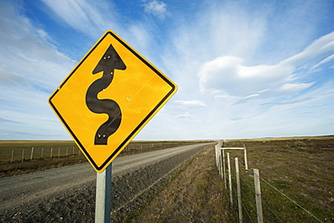 Sign For Curving Gravel Road, Punta Arenas, Magallanes, Chile