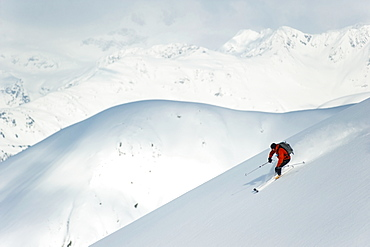 Man Skiing The West Face Of Peak 3720, Turnagain Arm, Chugach Mountains, Southcentral Alaska