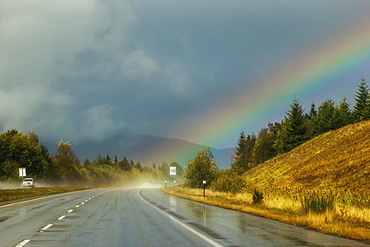 A Rainbow Comes From The Storm Clouds Right Onto The Highway Ahead, Parksville, British Columbia, Canada