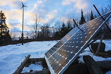 Solar Panel And Wind Turbine In Winter, Ontario, Canada