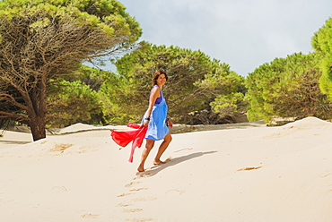 A Woman Walking On The Beach And Smiling At The Camera, Tarifa, Cadiz, Andalusia, Spain
