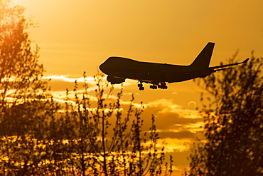 Silhouette Of A 747 Landing At Ted Stevens International Airport, Anchorage, Alaska, United States Of America
