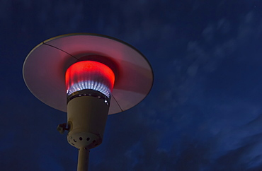 A Propane Torch Lamp Is Lit At Night, Fort Mcmurray, Alberta, Canada