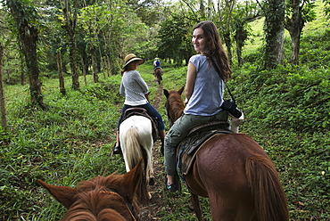 A Young Woman And Her Mother Riding Horses On A Trail, Zacapa, Guatemala