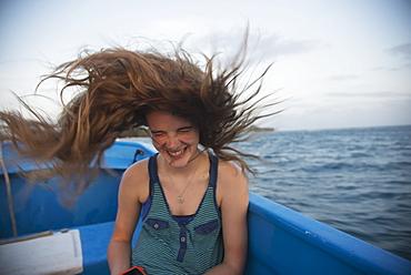 A Girl's Long Hair Whipping Through The Air On A Boat Ride, Utila, Bay Islands, Honduras