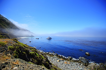 Seascape Of The Pacific Ocean Near Big Sur In California With The Fog Rolling Over The Horizon, California, United States Of America